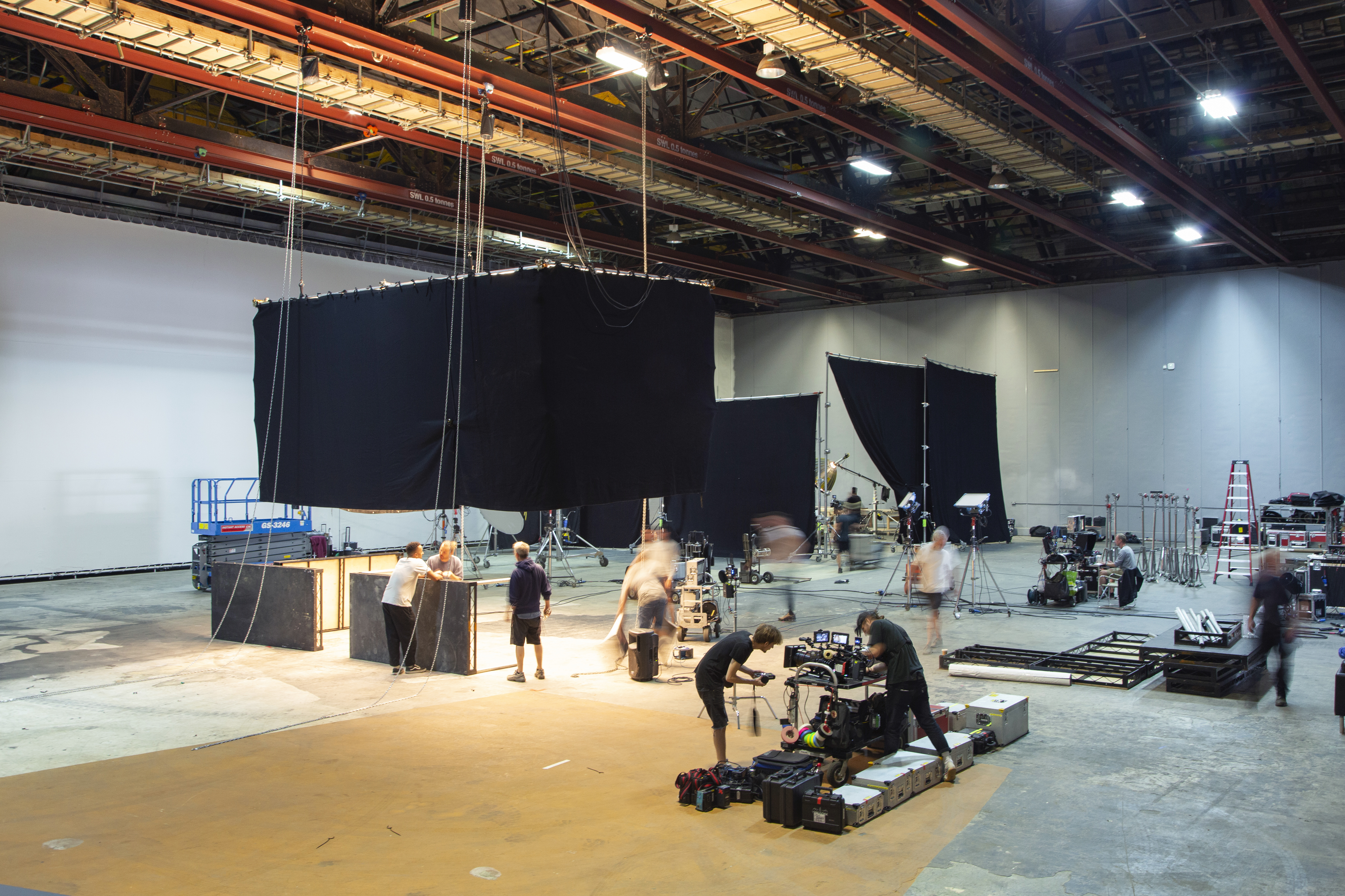Busy film studio with large hanging drapes